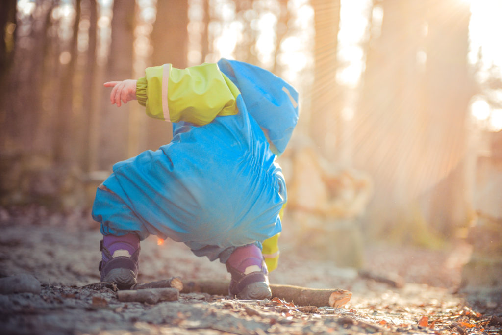 In this photo you can see a toddler playing outside. This is one of the many suggestions for Montessori activities for toddlers.